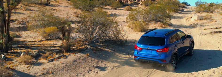 Mitsubishi awards Blue Outlander Sport driving through desert