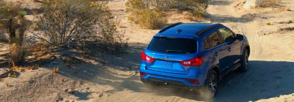 Mitsubishi Outlander Sport driving through wilderness