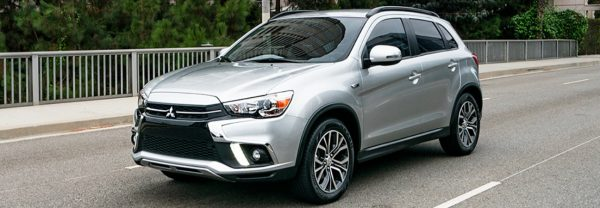 Silver 2019 Mitsubishi Outlander Sport driving down the road