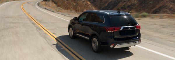 2019 Mitsubishi Outlander driving down the highway